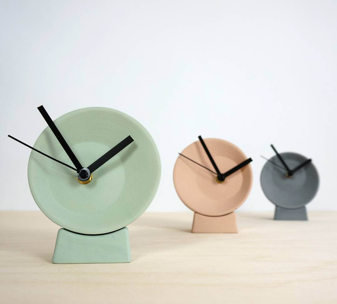 Off-center clock, in pastel colors: green, pink or grey