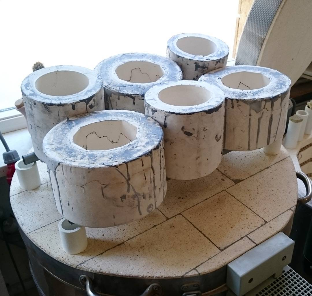 To speed up the casting process, we let the molds dry overnight above the hot kiln