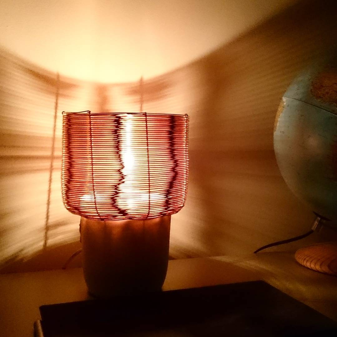 Quite surprised by the reflection of the our copper side lamp
