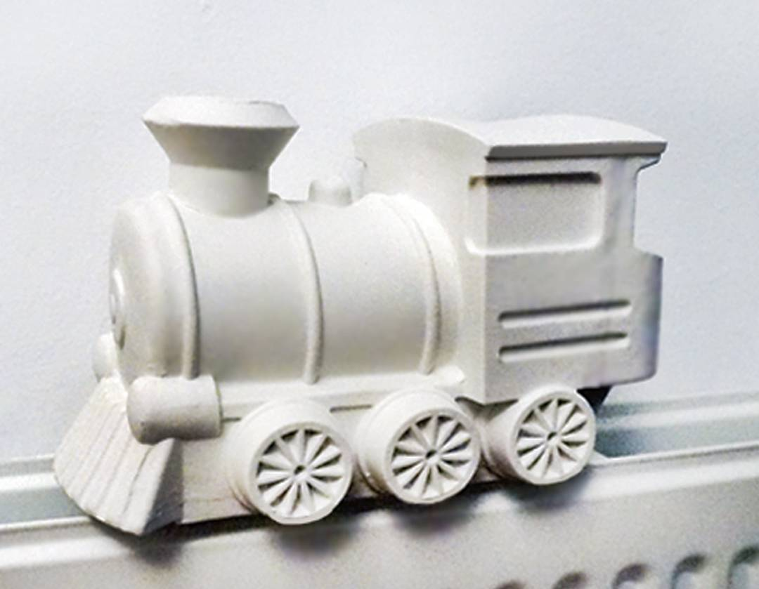 Fill this porcelain train with water and put it on your heater, so it becomes a steamtrain humidifier