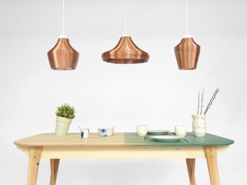 The full set of copper pendant lamps, above our table