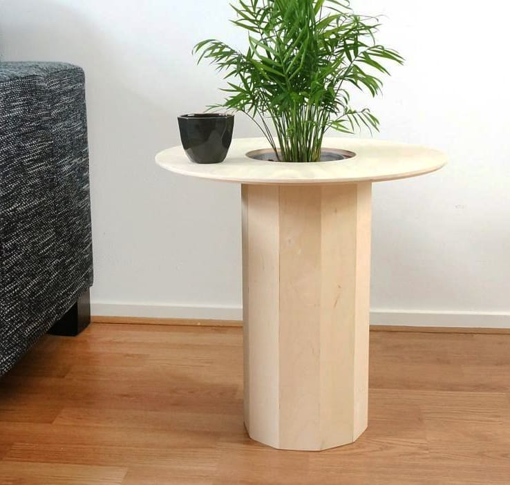 How about a side table and flowerpot in one?